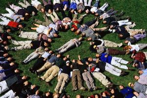 Adolescents Lying Down in a Circle on the Grass
